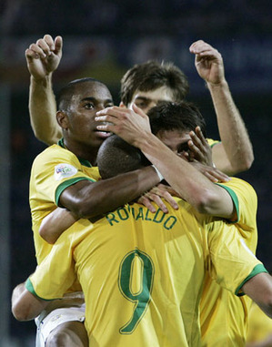 Brazil's Ronaldo celebrates with team mates after scoring against Japan during Group F World Cup 2006 soccer match in Dortmund